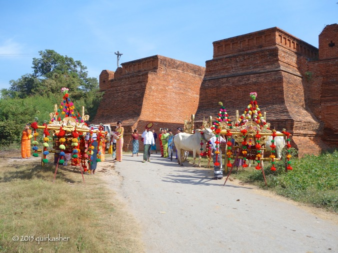 Waiting for the procession to start at the gateway to ancient Innwa