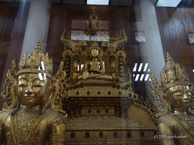 Bronze statues of Buddha on display
