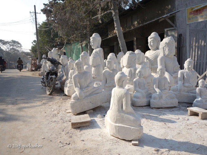 Marble statues along the street