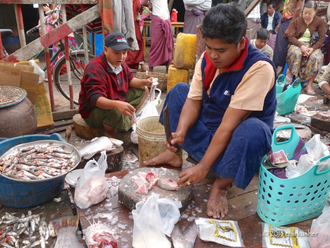 Chopping up the fish for its buyer