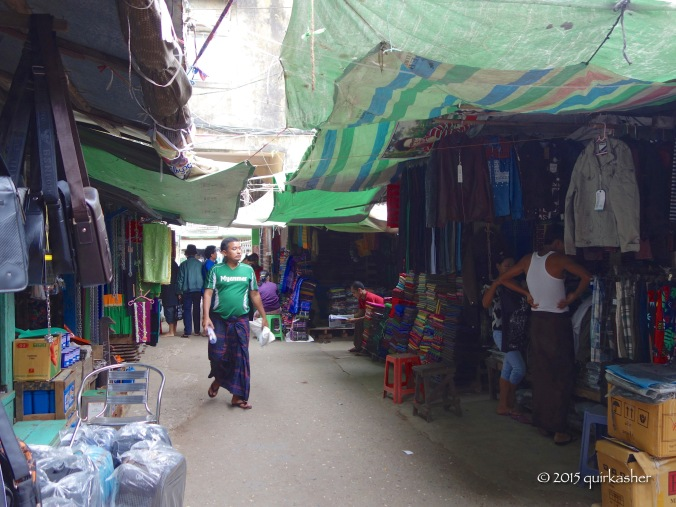 At the bags and longyi section of the market