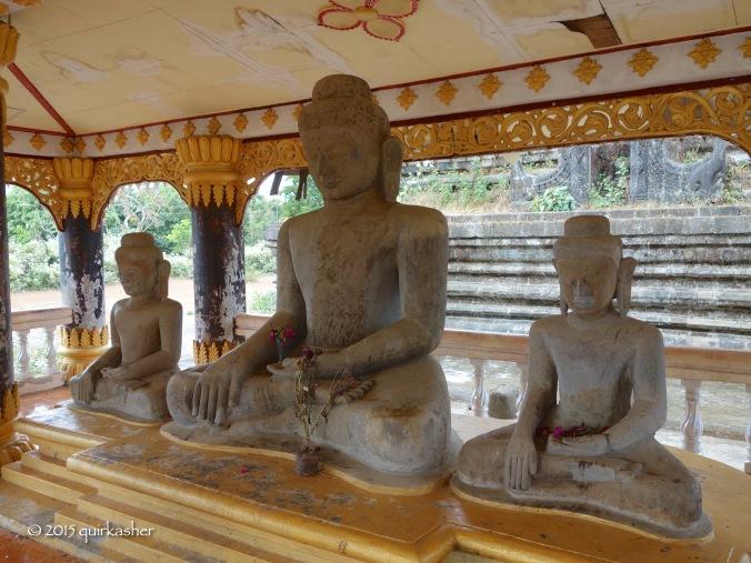 Modern statues beside ancient stupa