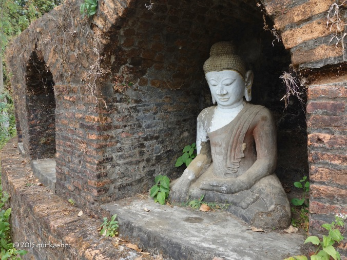 One of many Buddha statues on the exterior of Paya Ouk