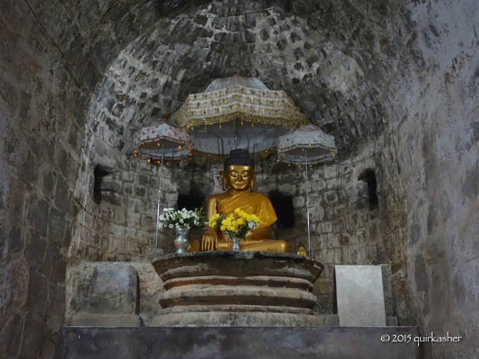 The Buddha statue at the end of the tunnel in Htukkanthein Temple