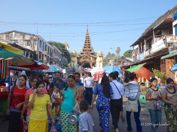 The crowds thronging the street leading to Shwedagon Pagoda