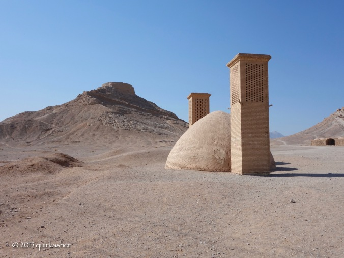 One of the towers of silence with a traditional water cistern in front (the two wind catchers help to ensure that the water stays fresh)