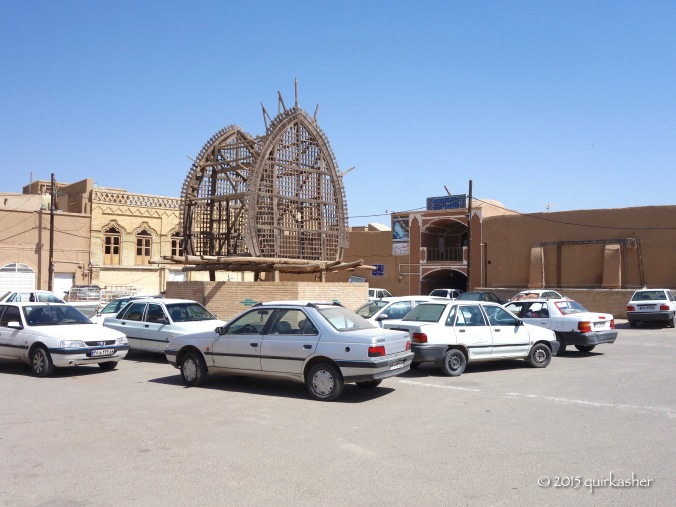 A nakhl in the middle of a carpark