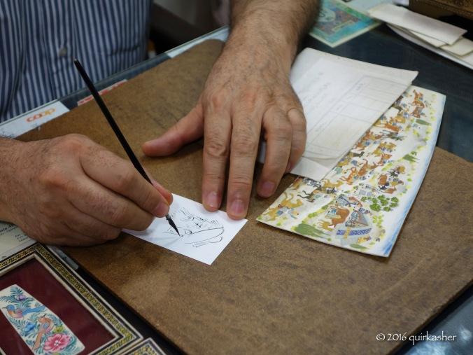 Painter of miniature art at the bazaar of Imam Square